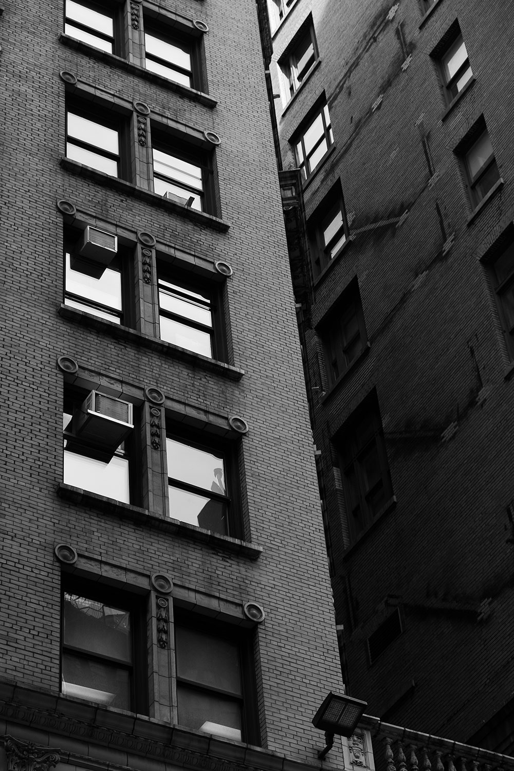 windows shine in the afternoon sun in NYC