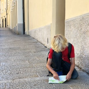 boy reading map in Europe