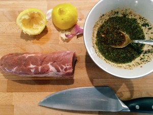 Pork fillet, squeezed lemon and a large knife