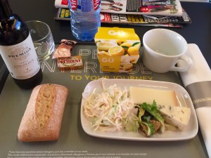Shot showing the meal I had on the Eurostar, cheese, wine, bread and a lemon cheesecake.