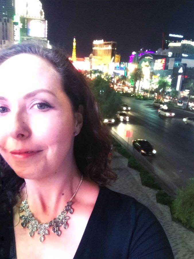 A selfie of me with the Las Vegas lights in the background