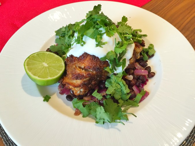 Mexican chicken thighs with piles of Greek yoghurt and coriander