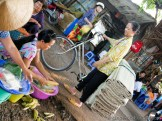 Mekong Lady Buying Steamed Corn on the Cob