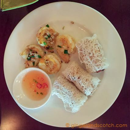Deep-fried spring rolls with crab, shrimp and shitake mushrooms; served with rice noodles and fresh herbs