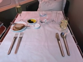 Qantas A380 first class with bread and wine