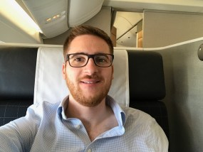 Ginger Travel Guru sitting in Swiss 777-300 first class seat 1K