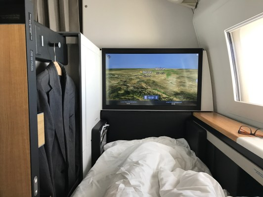 Swiss 777-300 first class suite with door closed and a view of the screen