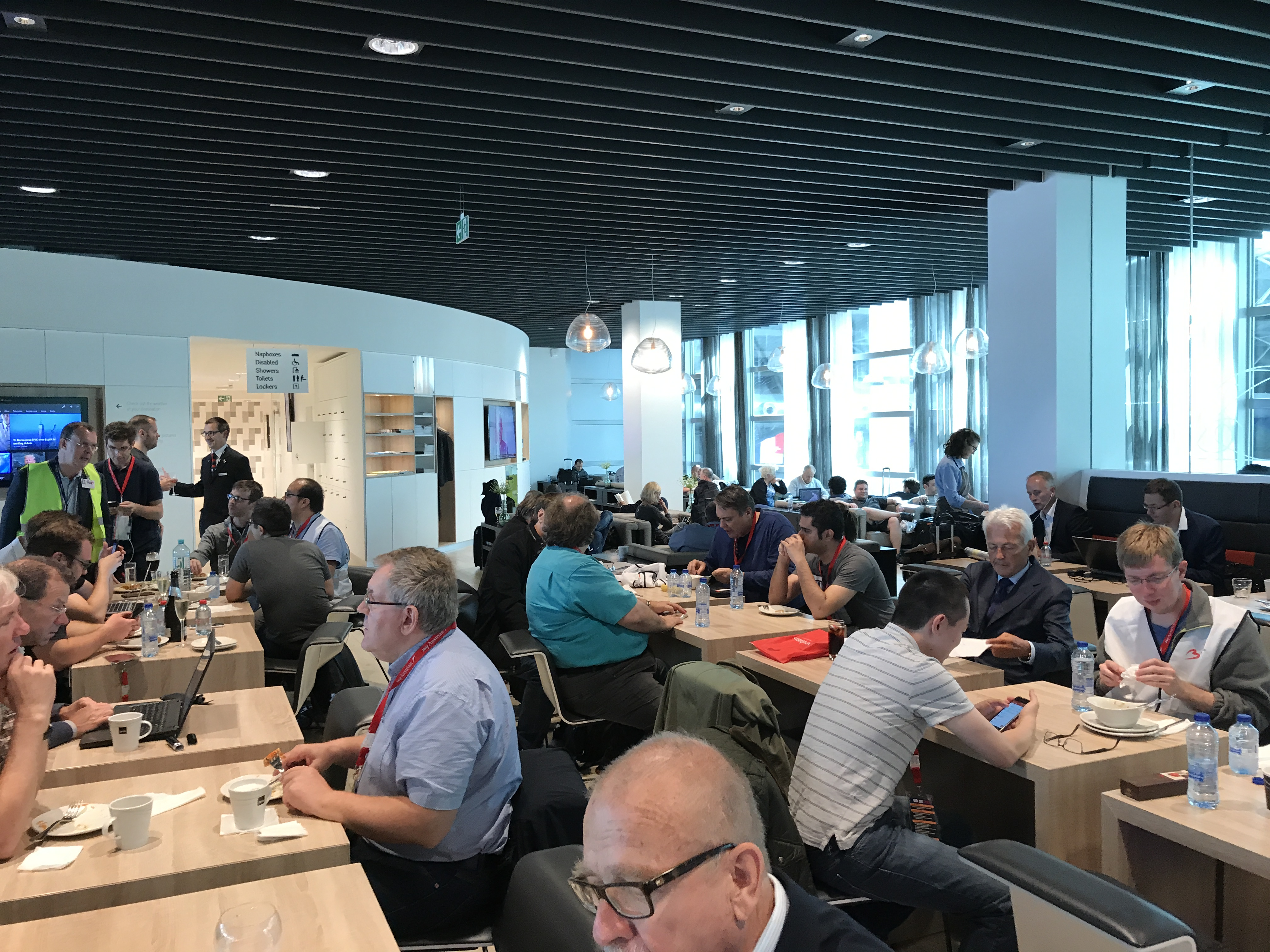 people working in the business class lounge at Brussels airport