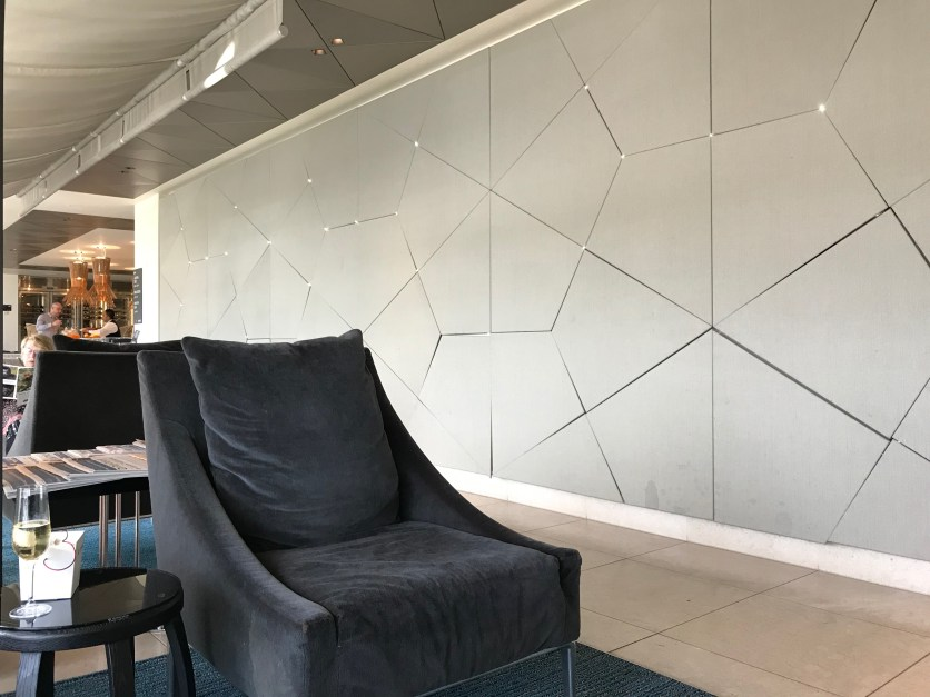 Qatar Premium Lounge Heathrow armchair with sparkling lights in the wall