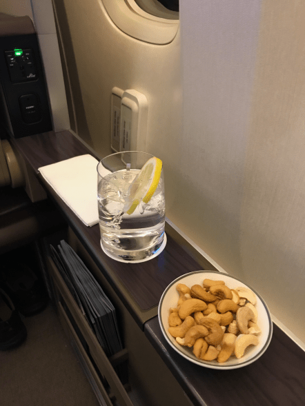 Singapore Airlines first class gin and tonic with nuts