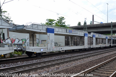 Belgian registered Laaers car transporter wagon 23 88 4356 019-0 passes through Hamburg Harburg station in Germany on the 18th July 2012