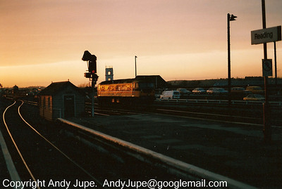 An unidentified class 47 departs west from Reading heading into the sunset