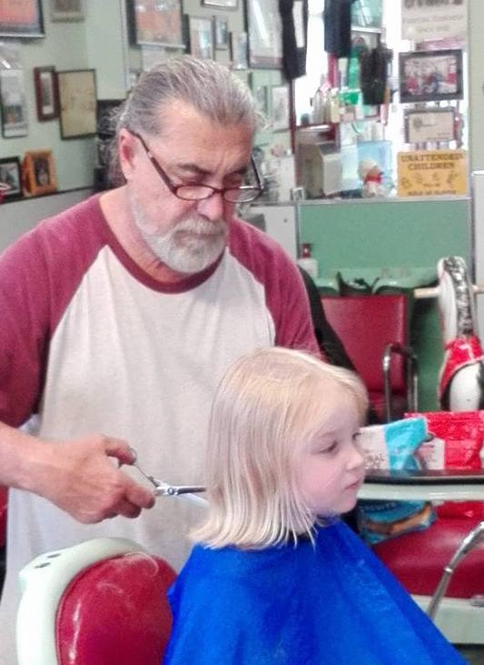 Isla and Joe at Bart's Barber Shop.