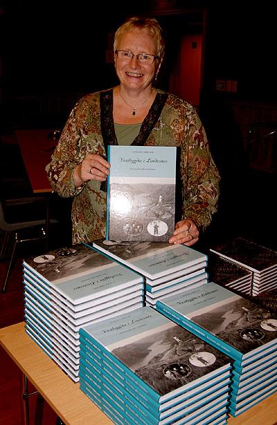 "Gunlaug Nøkland with her ""Vestbygda-book"""