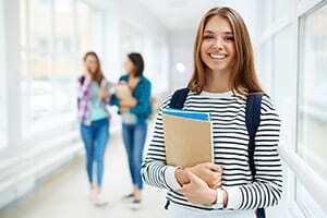Successful college female standing in hallway