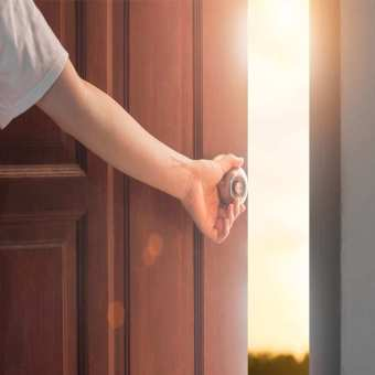 opening door to future with light coming in