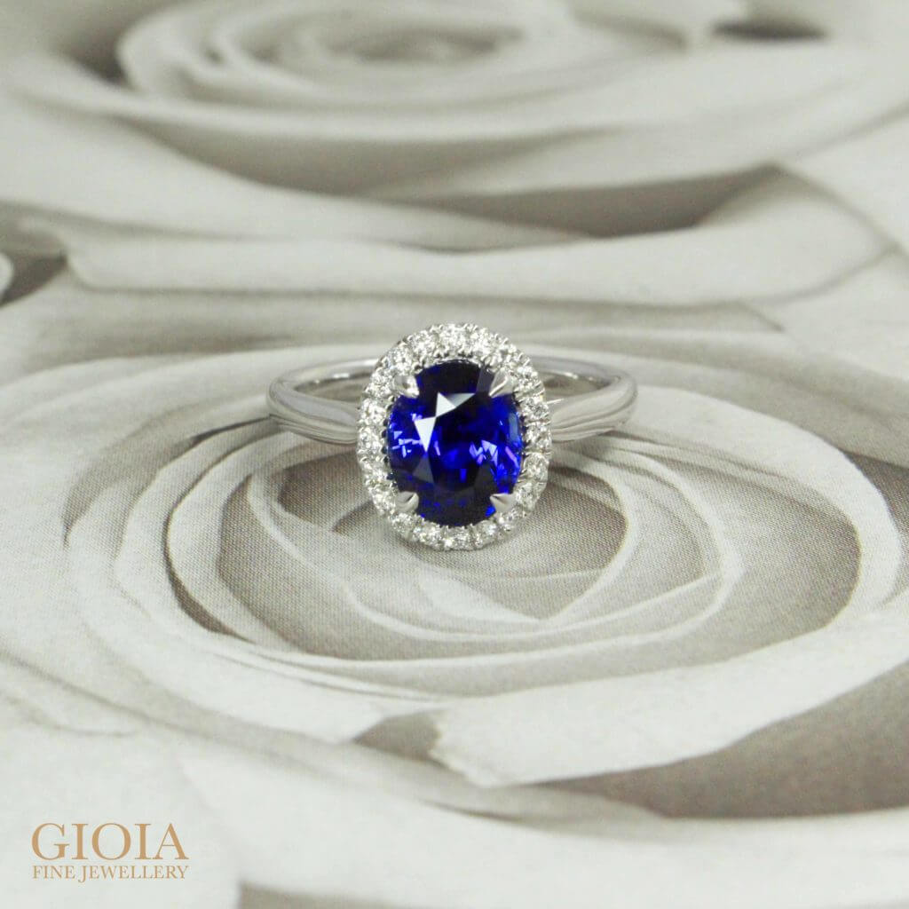 Royal Blue Sapphire unheated coloured gemstone, customised an engagement ring for a once in a lifetime proposal - Custom made it with round brilliant diamond halo surrounding the blue sapphire | Local Singapore Private Jeweller in bespoke jewellery