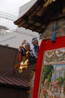 niwatori boko waving smiling men musicians gion festival procession kyoto japan
