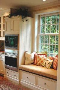 Comfy Window Reading Nook Next to Side of the White ...