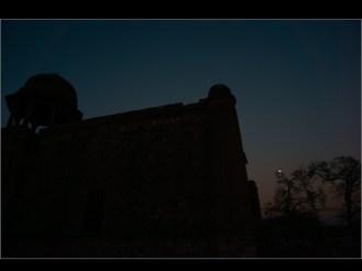 in Mehrauli village: a monument , moon, a bird