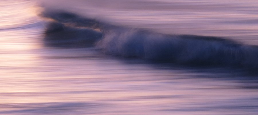 blurry purple gold wave ocean