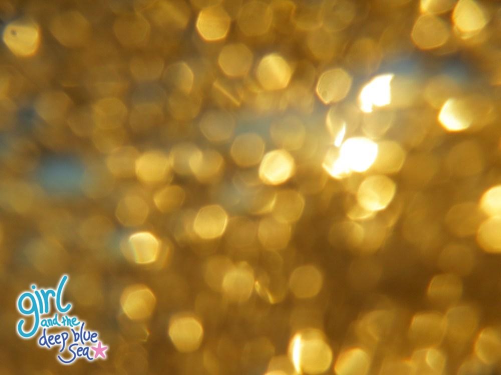 golden water sparkles hexagons