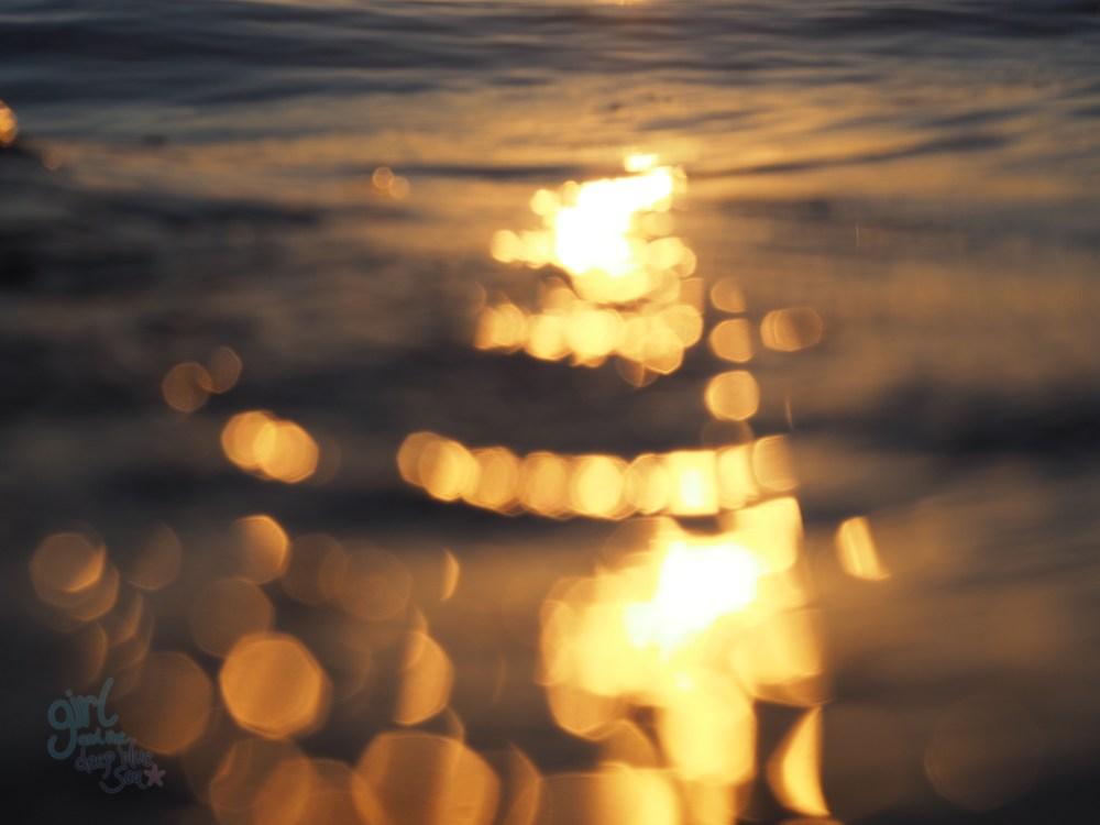 abstract golden light on ocean water