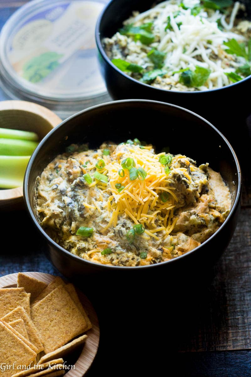 This incredible crock pot spinach and artichoke dip features 2 different dip in one crockpot with zero mess. With the aid of my simple trick you can turn one crockpot into 2 and make 2 completely different dips! I made things super simple by using La Terra Fina Artichoke Dips and had a buffalo chicken dip and a garlic spinach artichoke dip done in 90 minutes without dirtying up any dishes.