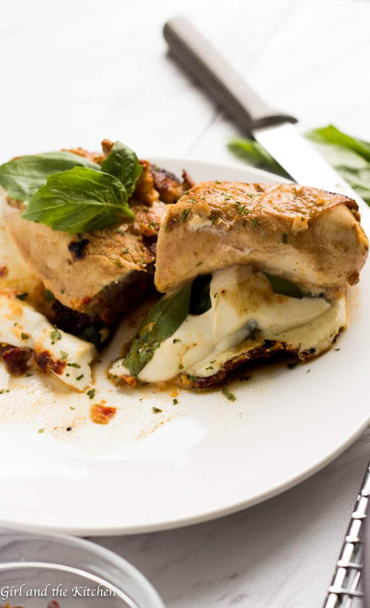 This Caprese Stuffed Chicken Breast is my solution when I want dinner on the table fast. Marinaded in a delicious balsamic dressing and stuffed with a sun-dried tomato mayonnaise, fresh mozzarella and plenty of basil, this super fast meal will leave everyone at the table asking for seconds!
