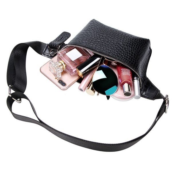 A photo showing an alligator-patterned black waist bag with items showing from its inside such as a phone, perfume, glasses, and makeup products.