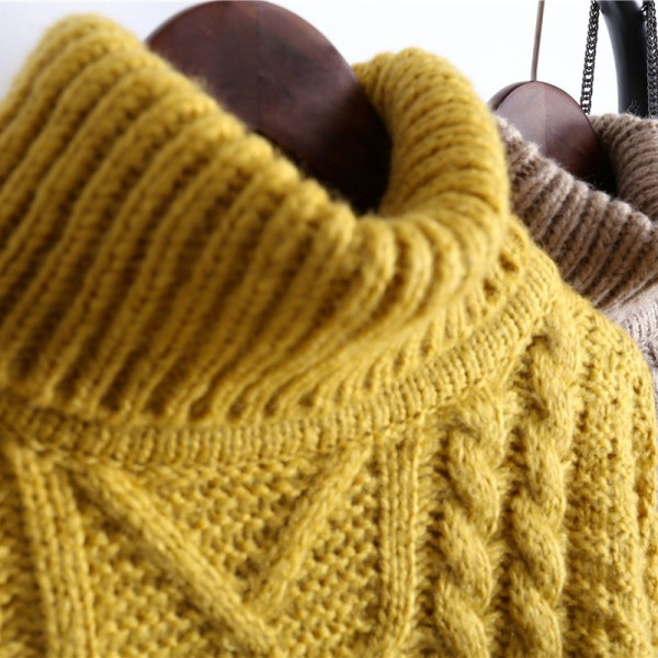 Turtleneck Knit Sweaters close up on clothes rack