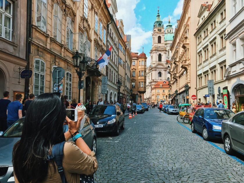Me, taking a photo in Old Town Prague and trying not to get hit by traffic.