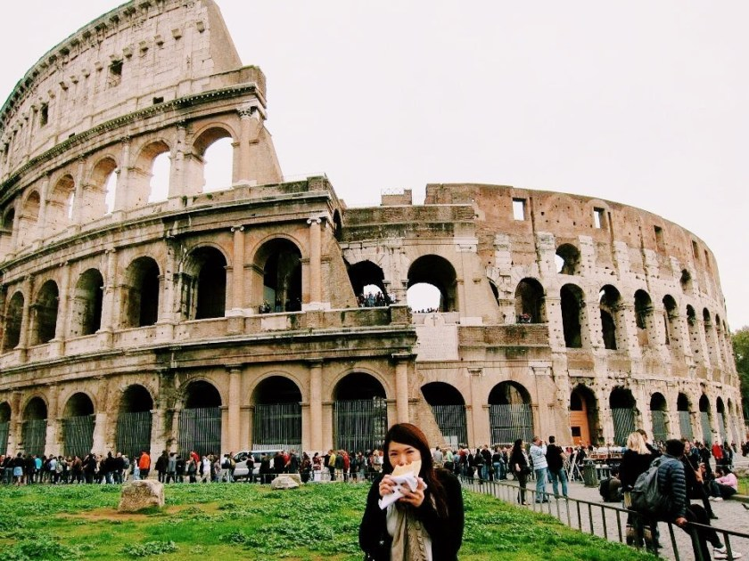 Eating in front of the Colosseum