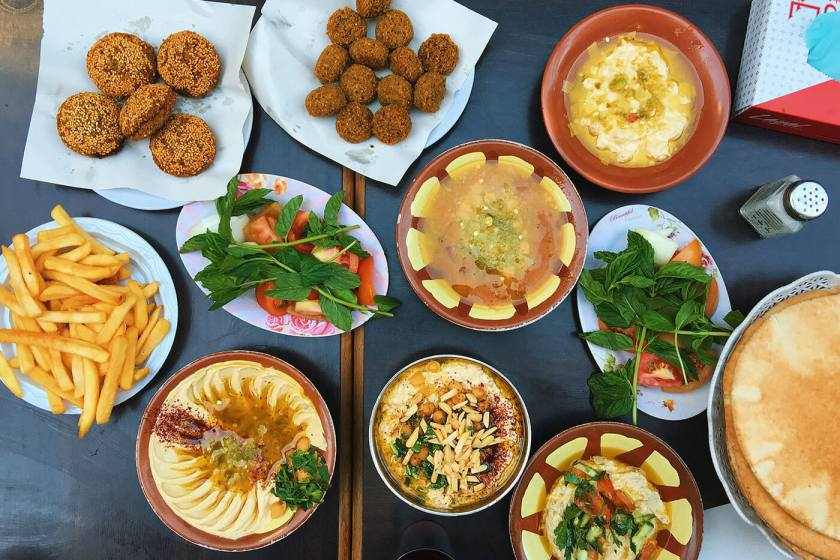 Hashem Restaurant - A spread of hummus, falafel, mutabal and ful medames in Amman