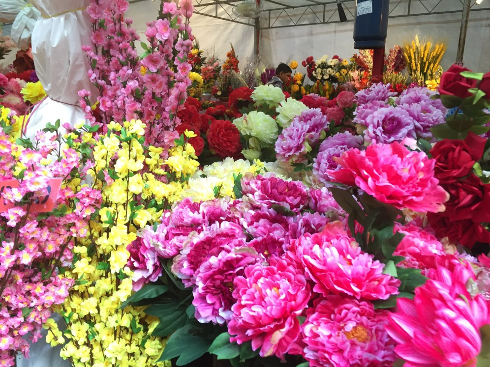 silk flowers at a CNY market