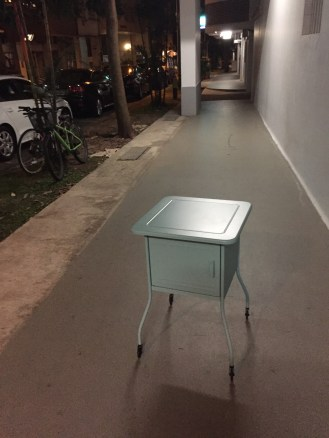 Buying furnature on the cheap= me rolling my new table through the streets late at night.