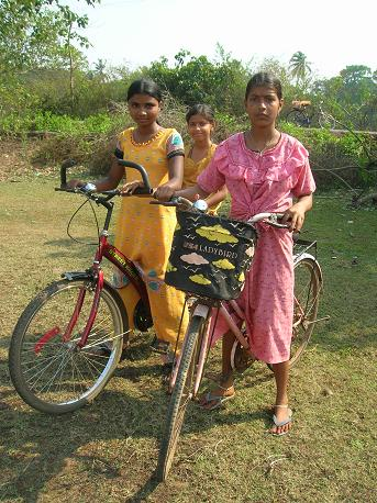 Local girls take to their cycles on a quiet Sunday afternoon in Siolim, Bardez.