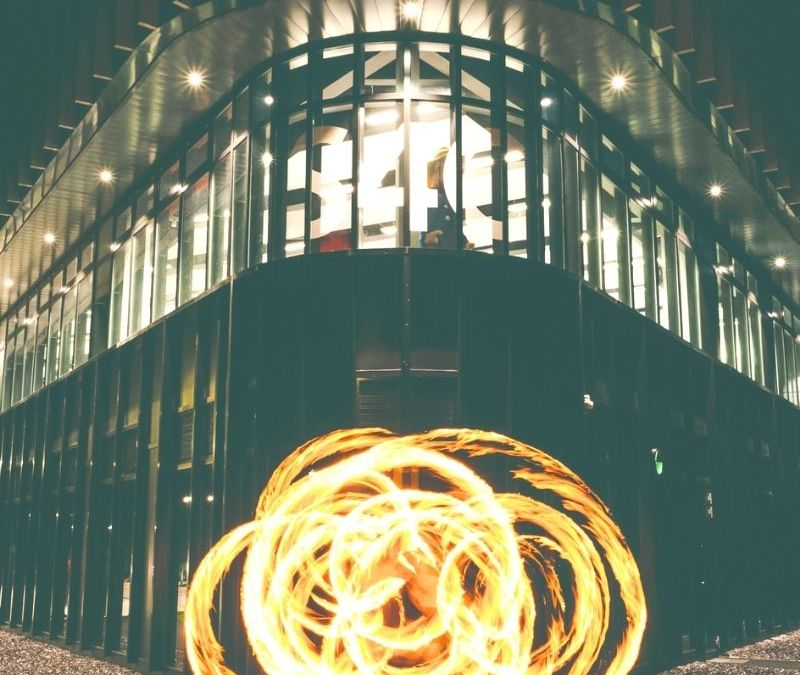 fire spinning in front of a building