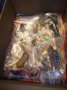 Box of Girl Guide Badges and Pins