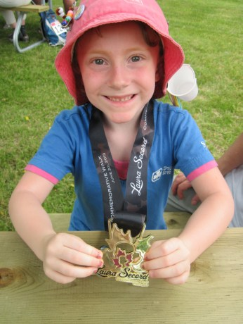 Megan's daughter at the end of the hike, with her medallion for completing the Laura Secord Walk!