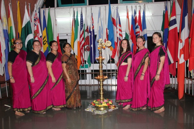 Melissa (third from right) and fellow Sangam staff and volunteers wearing Sangam saris.