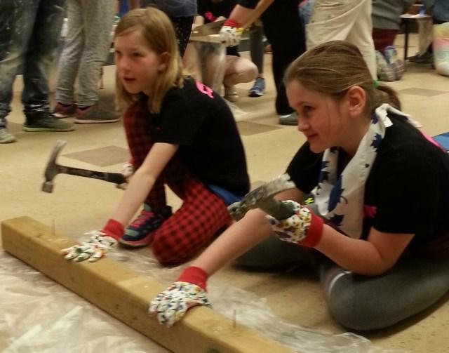 Girls hammering