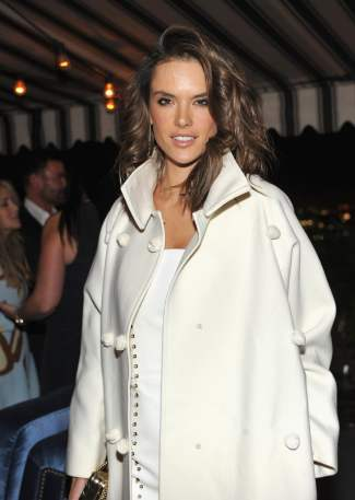 Victoria's Secret angel Alessandra Ambrosio and all-around beauty queen wears white wool to make the season bright.