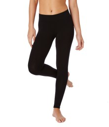 Female wearing black PACT leggings