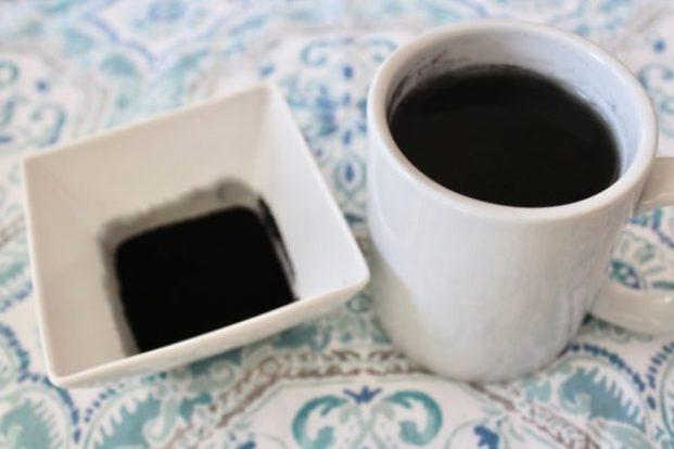 Mug and dish of charcoal on blue towel