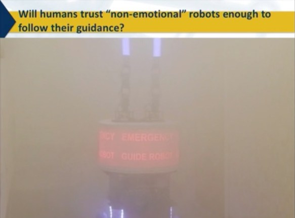 "A robot that is guiding humans through the smoke. Will humans trust ""non-emotional"" robots enough to follow their guidance? NeurIPS 2018"