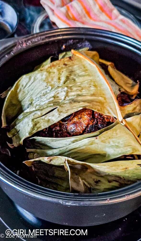 peak at pork under the baked banana leaves