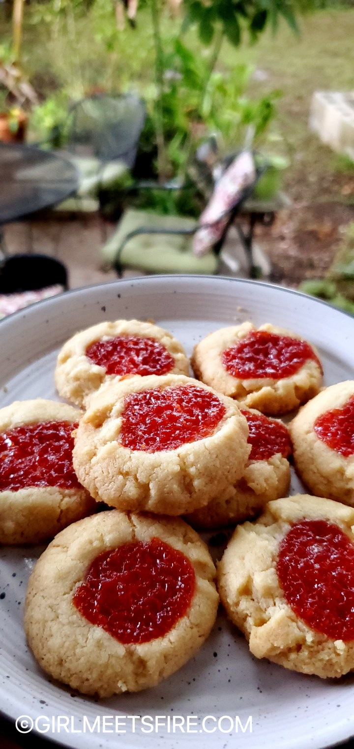 a white plate with guava topped polvorones