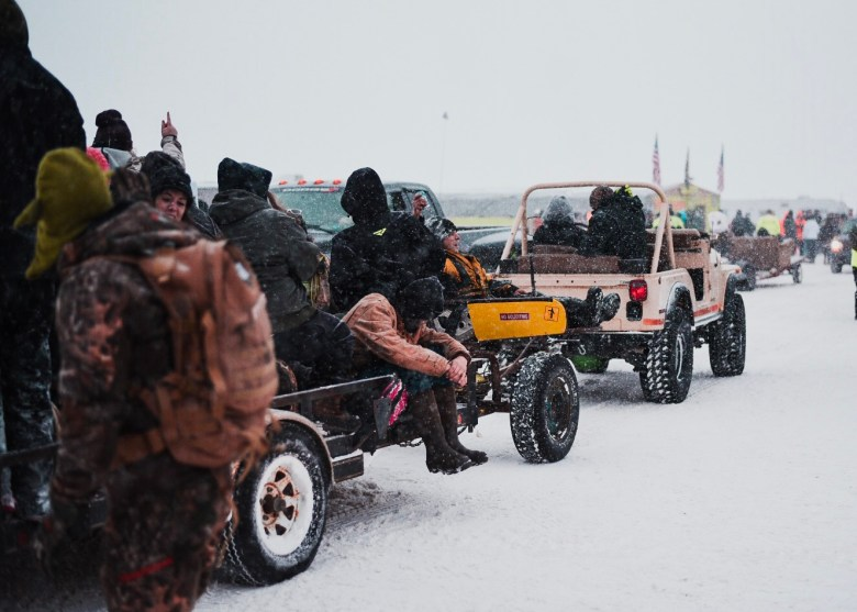 Jeep pulling people in wagon