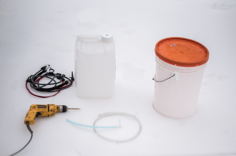 Maple Syrup Tapping Kit, container, drill, spout, tubing, and bungy cord